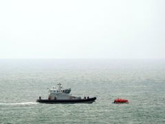 A Border Force vessel intercepts a group of people thought to be migrants in a small boat off the coast of Dover in Kent. (Gareth Fuller/PA)