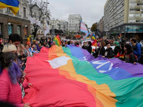 People take part in the annual Gay Pride parade, under the protection of riot police in Kyiv, Ukraine (Efrem Lukatsky/AP)
