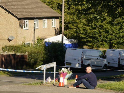 The father to some of the victims leaves flowers at the scene in Chandos Crescent, Killamarsh, near Sheffield, where four people were found dead at a house on Sunday. Derbyshire Police said a man is in police custody and they are not looking for anyone else in connection with the deaths. Picture date: Monday September 20, 2021.