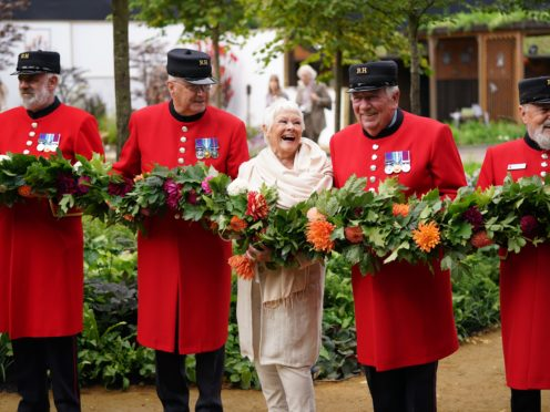 Dame Judi Dench with Chelsea Pensioners during the RHS Chelsea Flower Show press day, at the Royal Hospital Chelsea, London (Yui Mok/PA)