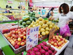 People buy fruit at a grocery store in Taipei, Taiwan (Chiany Ying-ying/ AP)