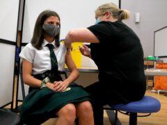 School pupil getting coronavirus vaccination (Andrew Milligan/PA)