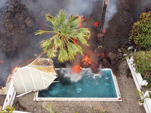 Hot lava reaches a swimming pool on the island of La Palma (Europa Press via AP)