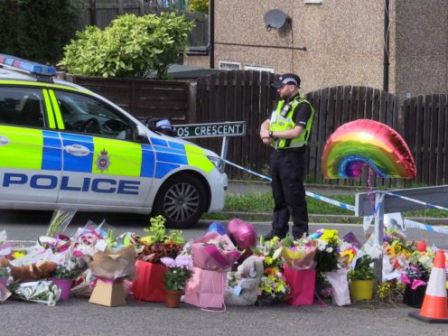 Flowers near to the scene in Chandos Crescent, Killamarsh, near Sheffield (Dave Higgens/PA)