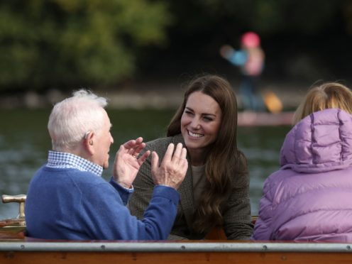 The Duchess of Cambridge (centre) meets Ike Alter and Diane Stoller in the steam launch Osprey (Scott Heppell/PA)