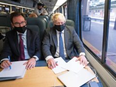 Prime Minister Boris Johnson spoke to reporters about Universal Credit while travelling on a train in the US (Stefan Rousseau/PA)