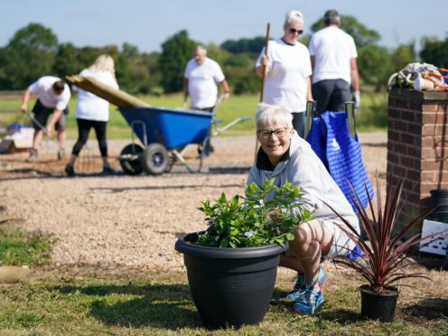 Terri Picton-Clark and other lottery winners help transform the yard at The Way of The Horse, in Lutterworth, Leicestershire (Jacob King/PA)
