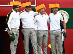 Team Europe's Lee Westwood, Ian Poulter, Rory McIlroy and Paul Casey (left-right) arrive on the first tee wearing Green Bay Packers cheesehead hats ahead of the 43rd Ryder Cup (Anthony Behar/PA)