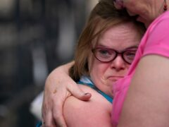 Heidi Crowter is comforted by her mother Liz outside the High Court in London (Gareth Fuller/PA)