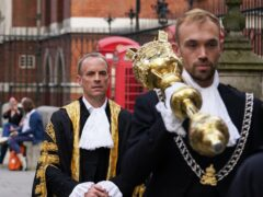 The new Lord Chancellor Dominic Raab (left) arrives at the Judges' entrance to the Royal Courts of Justice (GaretH Fuller/PA)