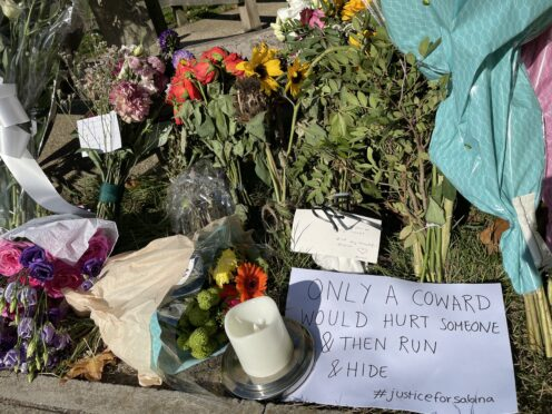 Floral tributes at Cator Park in Kidbrooke, south-east London, near to the scene where the body of Sabina Nessa was found (Laura Parnaby/PA)