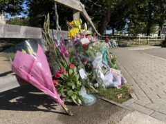 Floral tributes at Cator Park in Kidbrooke (Laura Parnaby/PA)