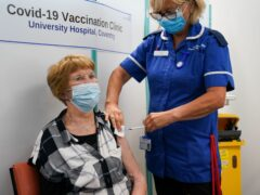 Margaret Keenan receives her booster shot from Julie Baines (Jacob King/PA)