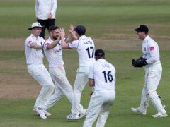 Chris Woakes celebrates after doismissing Jack Leach at Edgbaston (Bradley Collyer/PA)