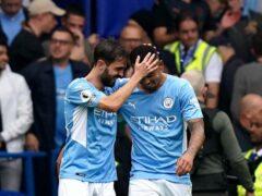 Manchester City's Gabriel Jesus (right) celebrates his winner at Stamford Bridge with Bernardo Silva (Adam Davy/PA)