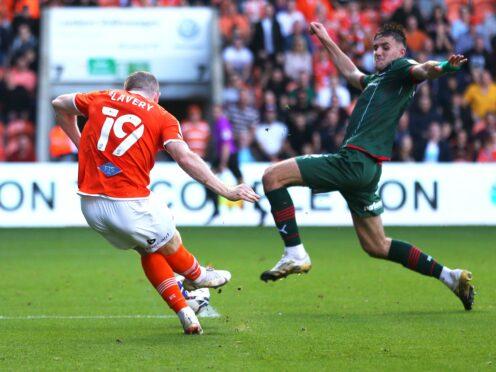 Shayne Lavery, left, scores Blackpool's winner (Tim Markland/PA)