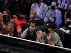 Roger Federer, centre, waves to the crowd while watching the Laver Cup (Elise Amendola/AP)