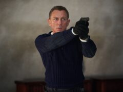 Daniel Craig playing James Bond in the new Bond film No Time To Die (Nicola Dove/PA)
