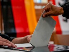 A man casts his ballot in the German elections in a polling station in Berlin (Michael Probst/AP)