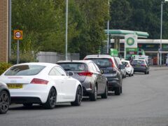 Cars queue for fuel at a BP petrol station in Bracknell, Berkshire (PA)