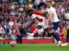Bukayo Saka, left, starred as Arsenal beat Tottenham (Nick Potts/PA)