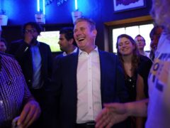 Labour Party leader Sir Keir Starmer speaks to members of the public as he watches the Arsenal v Tottenham Hotspur match at The Font pub in Brighton (PA)
