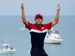Collin Morikawa celebrates as the United States regained the Ryder Cup (Ashley Landis/AP).