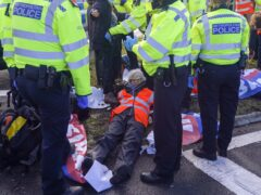 Police officers are under pressure to quickly remove climate activists blocking the M25 (Steve Parsons/PA)