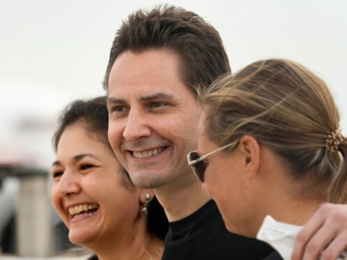 Michael Kovrig, centre, was detained with fellow Canadian Michael Spavor in December 2019 (Frank Gunn/The Canadian Press via AP)