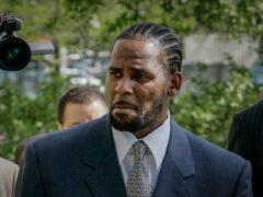 R Kelly arriving at court (Charles Rex Arbogast/AP)