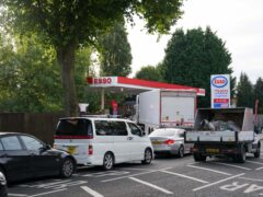 Drivers queue for fuel at an Esso petrol station in Bournville, Birmingham (Jacob King/PA)