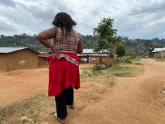 One alleged victim stands near her home in Beni, eastern DR Congo (AP)