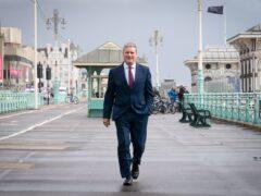 Labour leader Sir Keir Starmer walks along Brighton seafront (Stefan Rousseau/PA)