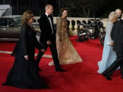 The Duke and Duchess of Cambridge (second left) and Barbara Broccoli (left) and The Duchess of Cornwall and Prince of Wales (right) arrive at the World Premiere of No Time To Die, at the Royal Albert Hall in London (Jonathan Brady/PA)