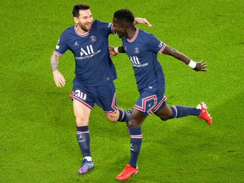 Paris St Germain goalscorers Lionel Messi, left, and Idrissa Gueye celebrate (Michel Euler/AP)