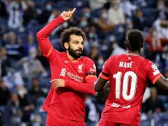 Mohamed Salah (left) scored twice for Liverpool (Luis Vieira/AP)