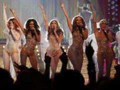 Girls Aloud performing on stage at the Brit Awards (Yui Mok/PA)