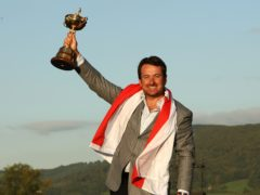 Graeme McDowell celebrates with the Ryder Cup trophy after Europe's win at Celtic Manor in 2010 (Lynne Cameron/PA)