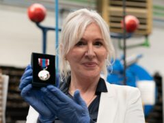 Culture Secretary Nadine Dorries during a visit to the Worcestershire Medal Service factory in Birmingham where the Queen's Platinum Jubilee Medal is being produced (Joe Giddens/PA)