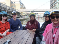 Nanjiba Misbah (middle) and other members of the RNIB on a boat trip (RNIB/GoBoat/PA)