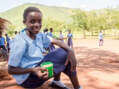 Olivia from Zambia receives a mug of Mary's Meals porridge each day which helps her concentrate at school (PA)