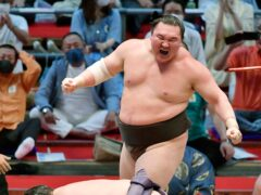 Hakuho's retirement marks the end of an era in the history of sumo (Kyodo News via AP)