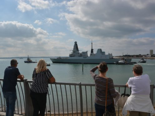 HMS Daring being towed from Portsmouth Naval Base (Ben Mitchell/PA)