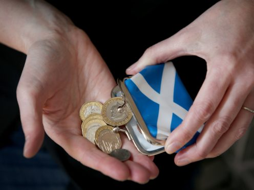 The £10 a week Scottish Child Payment has been described as a 'sticking plaster' by Cosla. (Jane Barlow/PA)