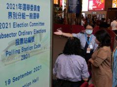 Voters enter a polling centre for the vote (Vincent Yu/AP/PA)