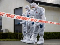 Police search the driveway of a house where three children were found dead in the South Island town of Timaru, New Zealand (New Zealand Herald/AP)