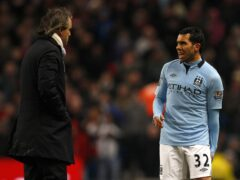 Manchester City manager Roberto Mancini (left) eventually welcomed Carlos Tevez (right) back into the squad (Dave Thompson/PA)