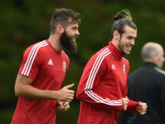Former Wales midfielder Joe Ledley (left) says the country's youngsters must handle the loss of Gareth Bale (right) in World Cup qualifiers (Joe Giddens/PA)