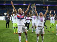 Lyon's Ada Hegerberg (left) and Eugenie Le Sommer celebrate winning the Women's Champions League final at the Cardiff City Stadium (Nick Potts/PA)
