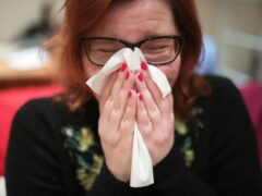 People are being urged not to grin and bear illness but stay away from the workplace if sick (Yui Mok/PA)